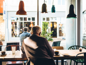man sitting at coffee shop