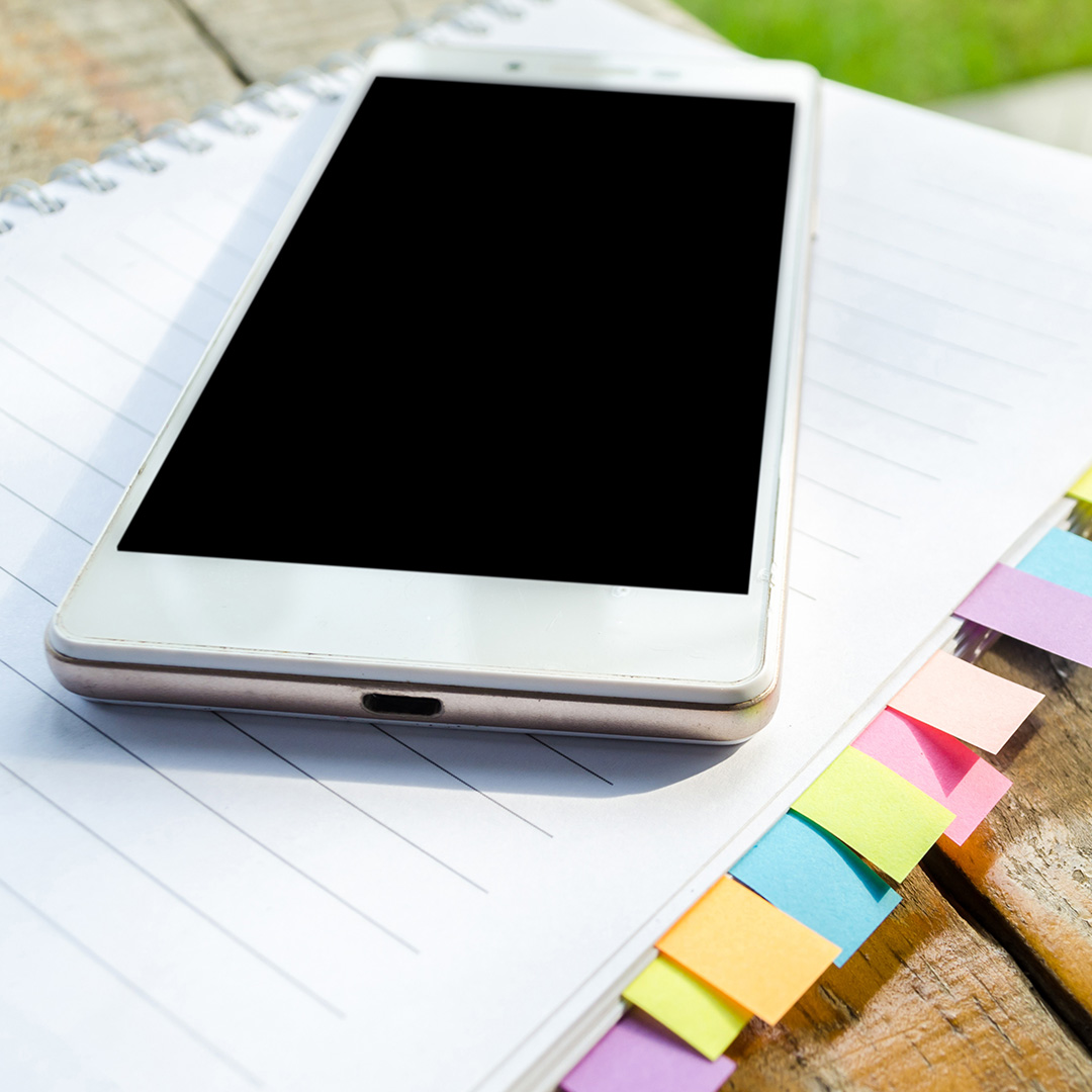 blank note book with and smart phone