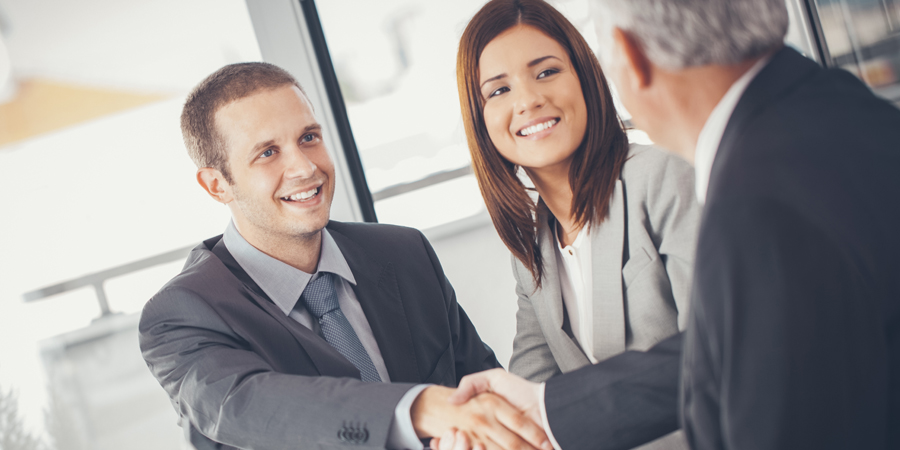 tax expert shaking hands with personal tax client