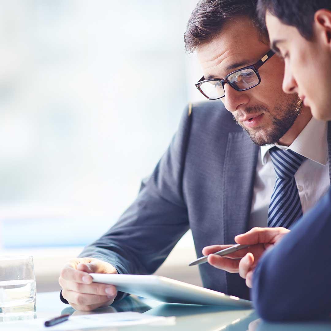 executives looking at data from Dynamics NAV 2018