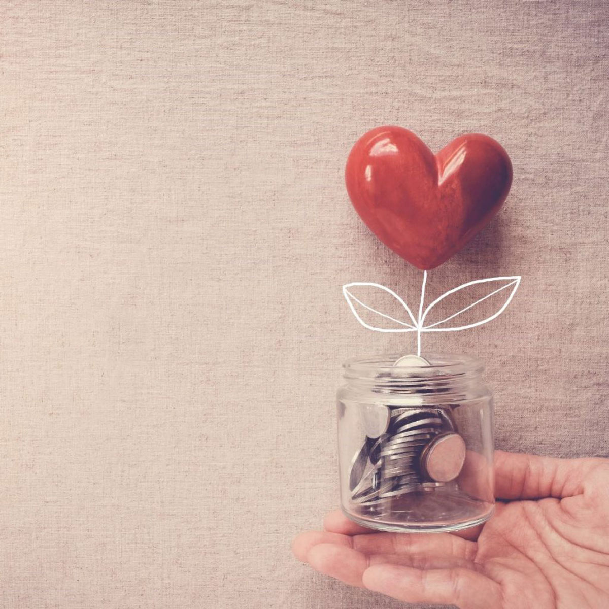 Heart in a jar full of coins