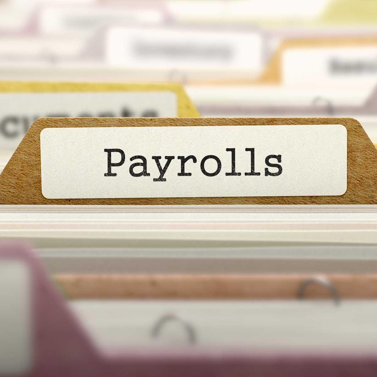 a folder tab among other folders labeled payroll