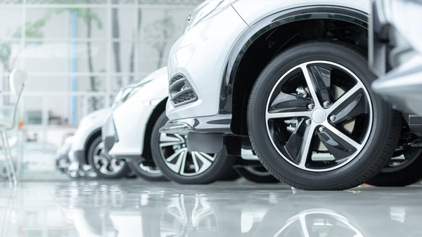 cars lined up after logged in automotive dealer management system