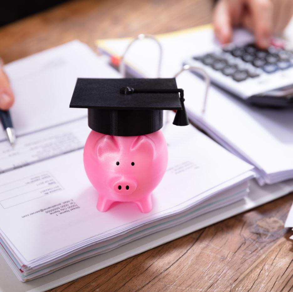 Pink Piggybank With Graduation Hat On Folder