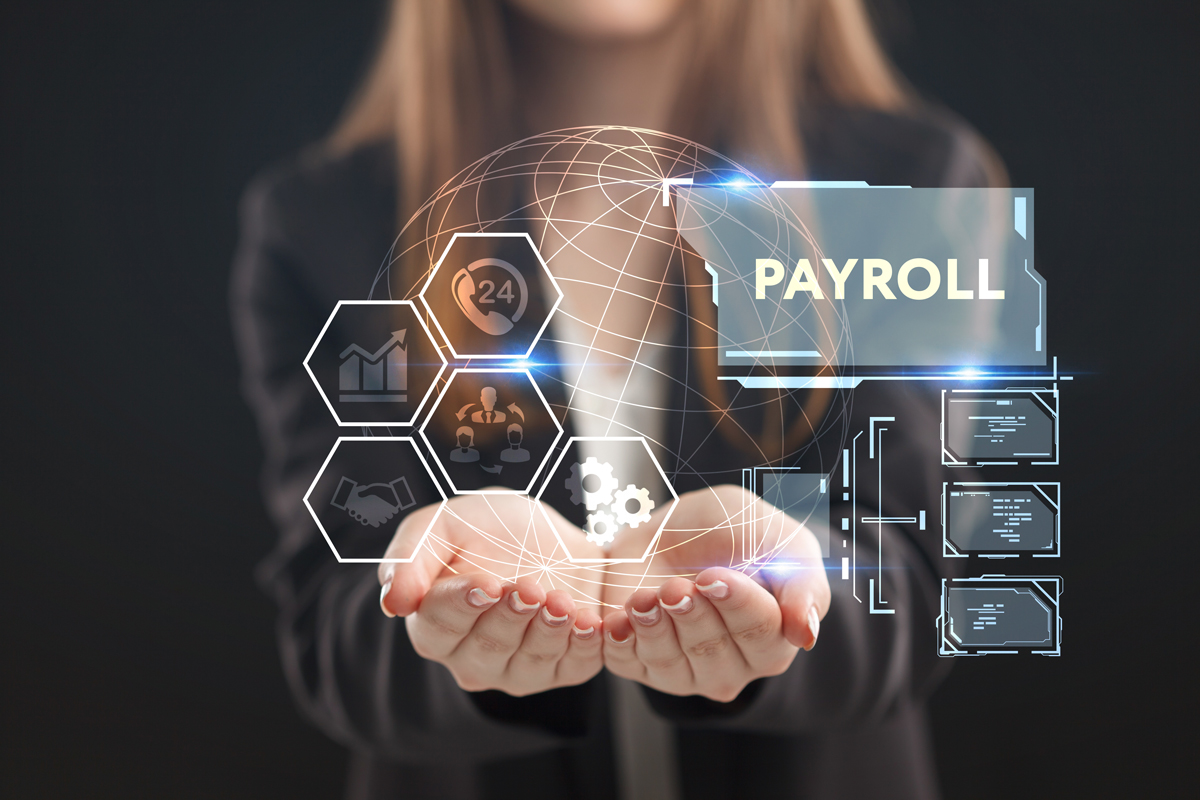 A young entrepreneur working on a virtual screen of the future and sees the inscription: Payroll