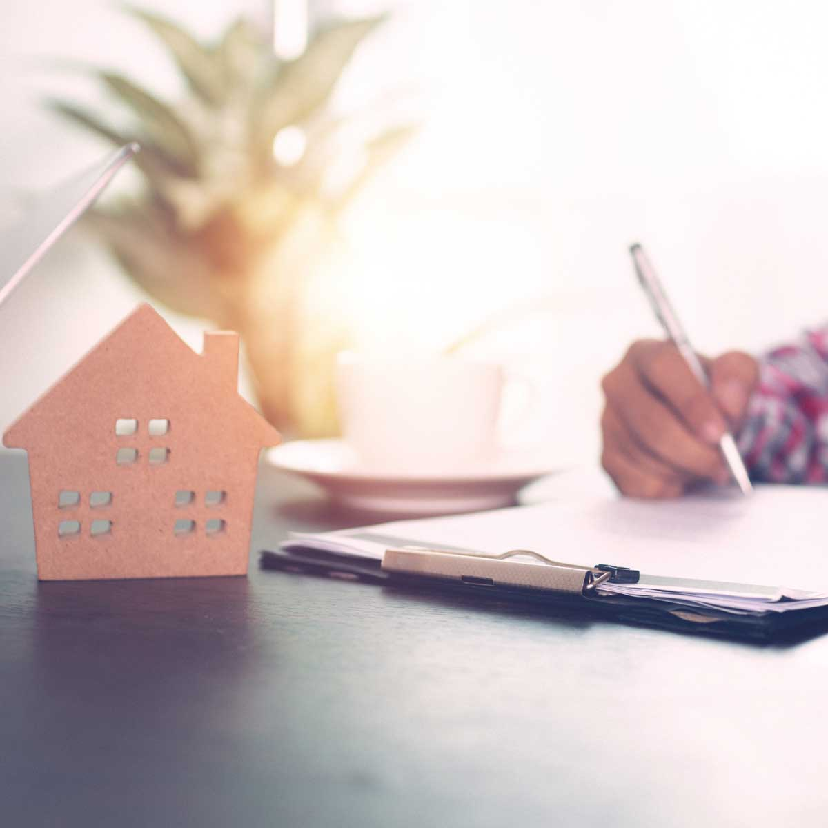 Home model with money on table with agency signing to approve for real estate background