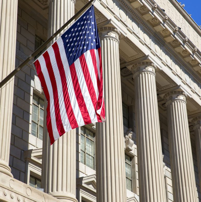 United States Flag in front of State Building