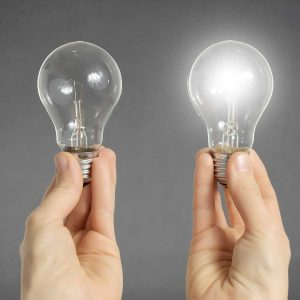 Decision making concept, hands with light bulbs