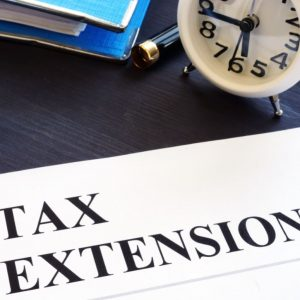 Tax extension. Folder with documents and clock.