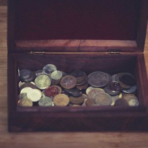 Vintage wooden vintage retro jewelry box with metal coins from different countries