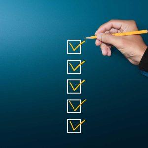 Orange marking on checklist box with pen, Checklist concept, copy space