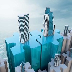 buildings connecting in a puzzle peace-merger and acquisition concept