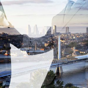 business partners shaking hands; transaction concept; image over a city skyline that fades into the picture