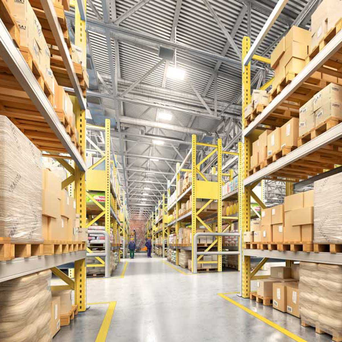 empty manufacturing warehouse with boxes and equipment stored along the walls