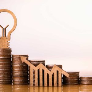 Light bulb and stack of coins in concept of savings and money growing or energy save. Business investment growth concept,money saving and Investment concept. retirement concept.