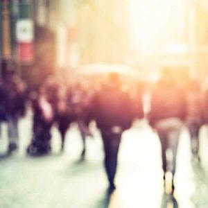 people walking in the street, blurry