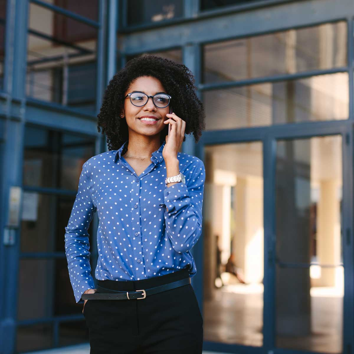 Business-professional-making-a-phone-call-outside-office-building