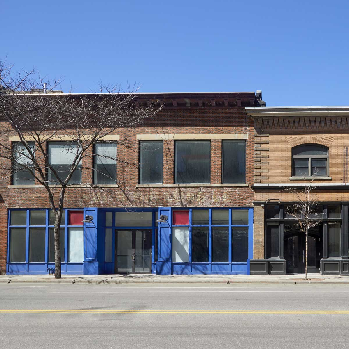 Empty storefronts on empty city street in northern city USA during Covid 19