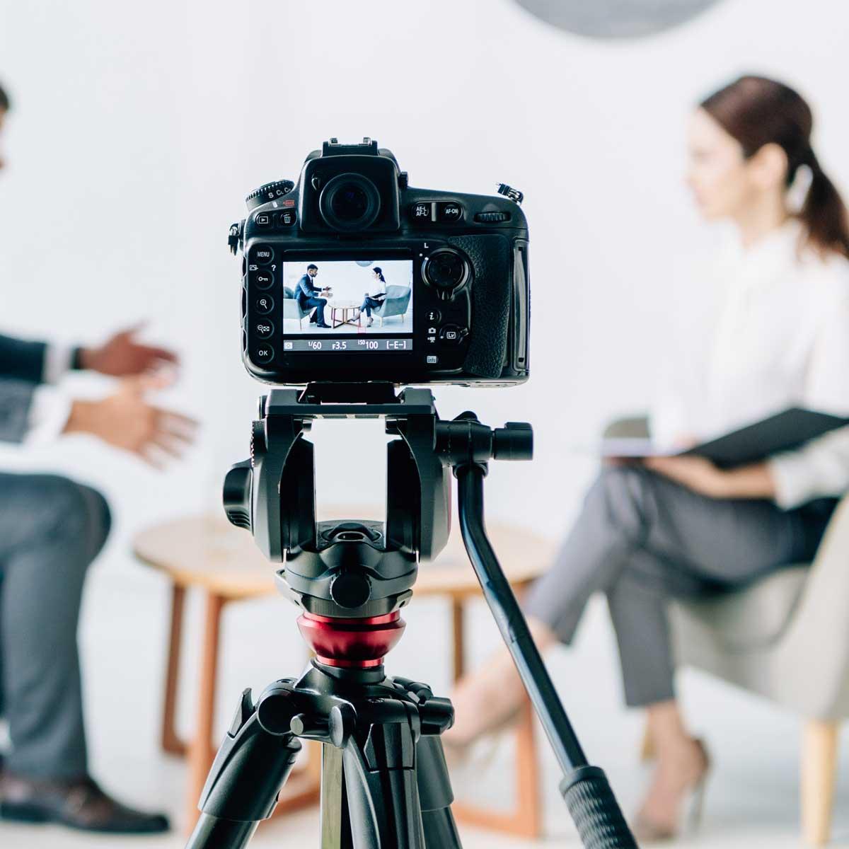 selective focus of digital camera shooting journalist and businessman