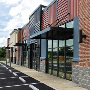brick building exterior; strip building with parking lot