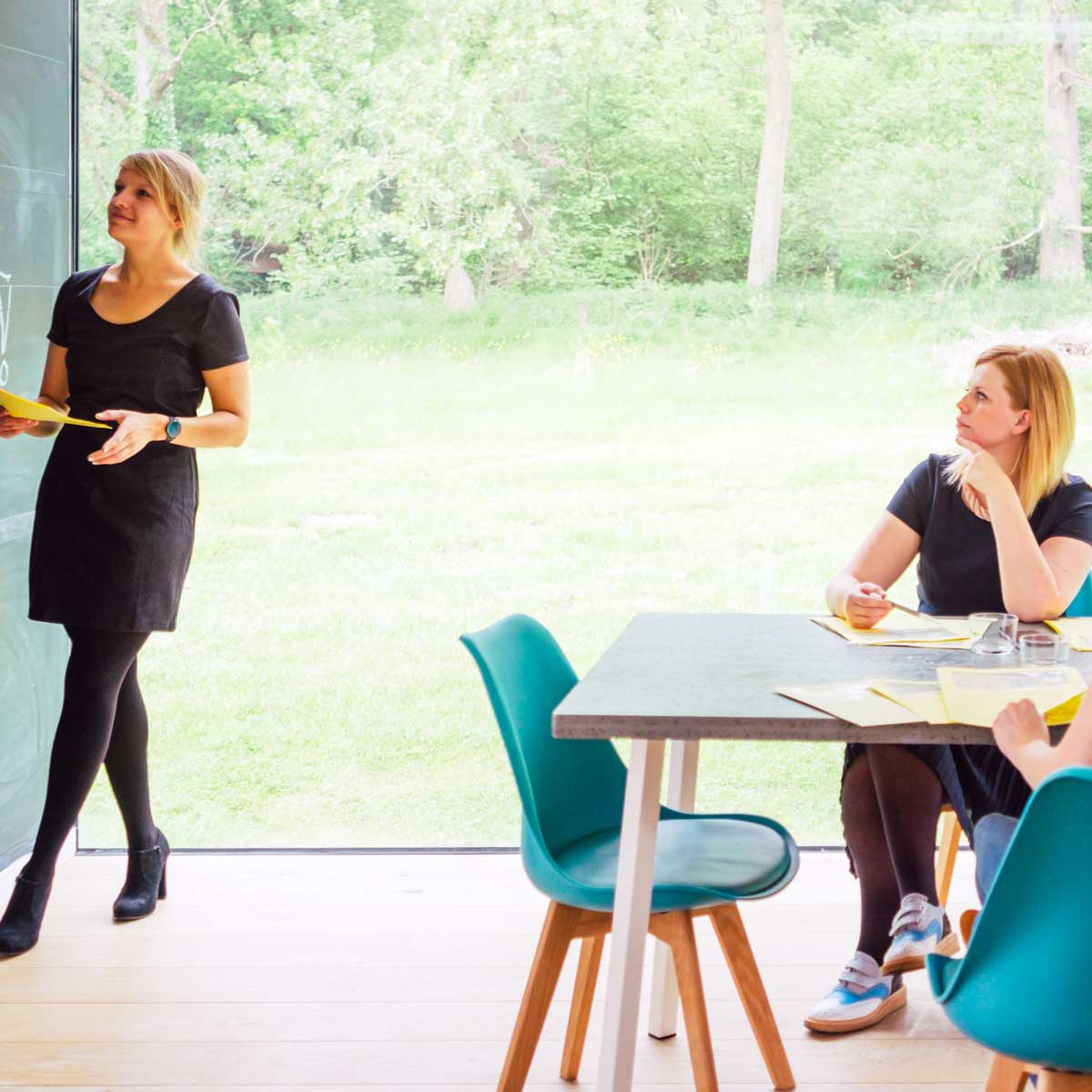 business meeting of a female startup - room with daylight, real people lifestyle
