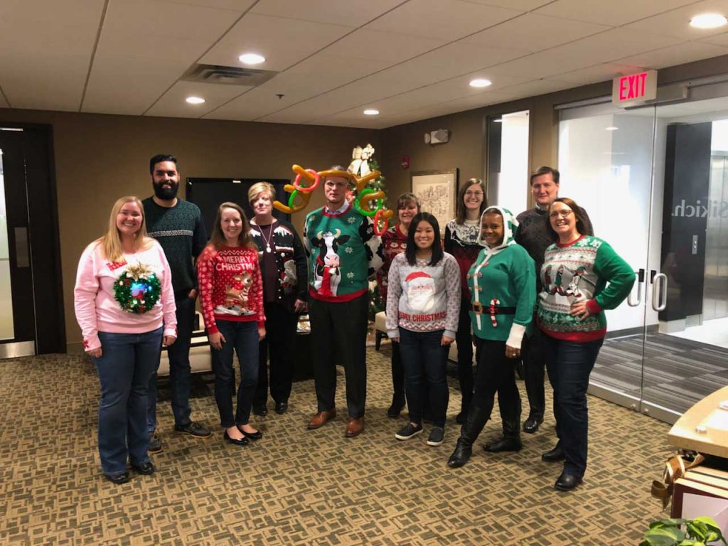 Sikich-Indianapolis-CPA-Group-dressed-for-winter-holiday-posing-for-picture