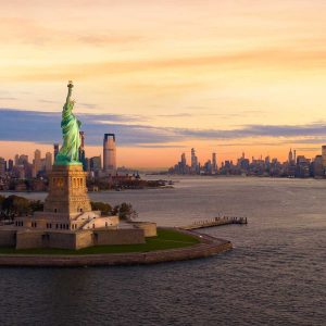 Liberty statue in New York city at sunset