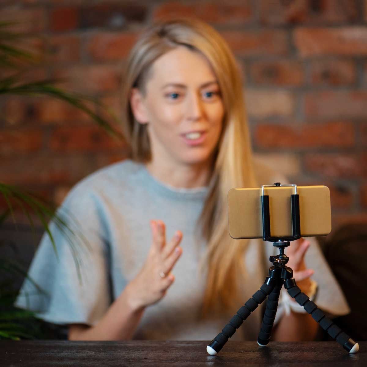business leader recording video at home using mobile phone