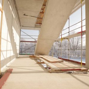 empty construction work site; wood interior; sun coming through glass windows