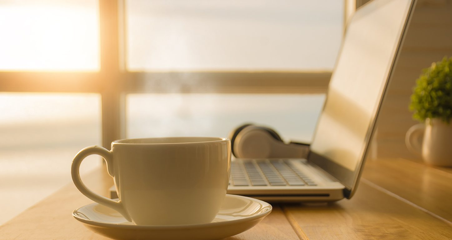 Morning Webinar with a cup of coffee at your desk