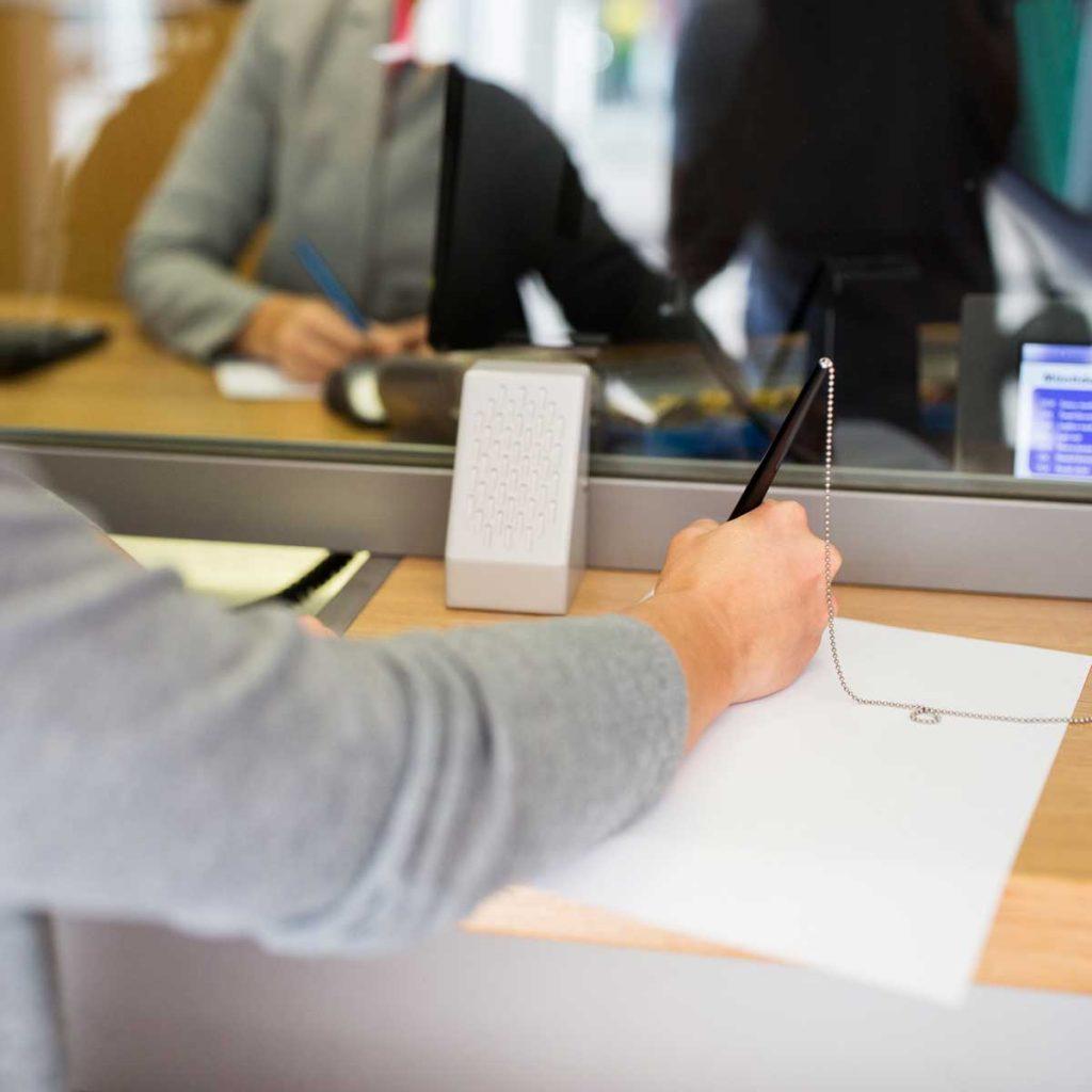 customer-writing-application-at-bank-office