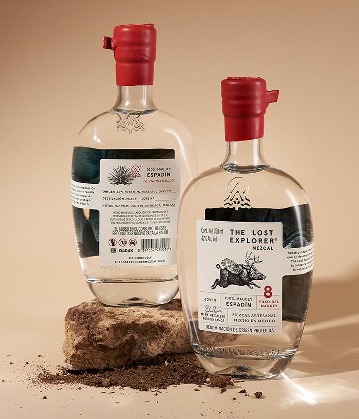 the lost explorer mezcal glass bottles and red lids