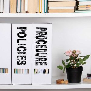 Policies and Procedure concept. document folders and organizers, white book shelf