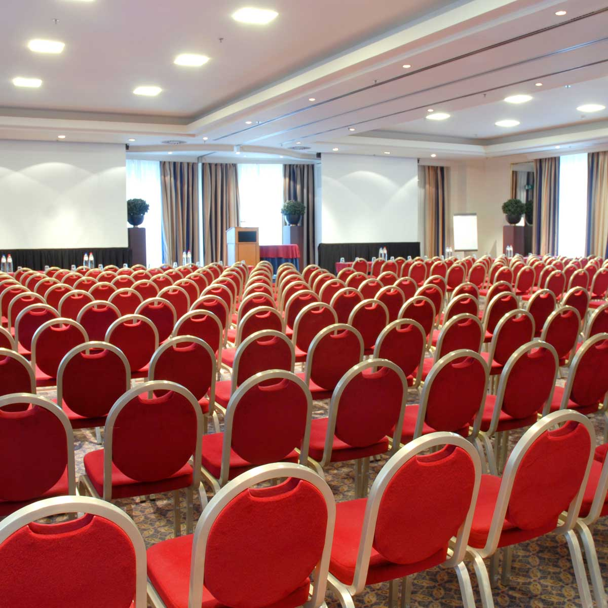 auditorium-and-banquet-event-hall-with-rows-of-red-velvet-chairs-for-guests