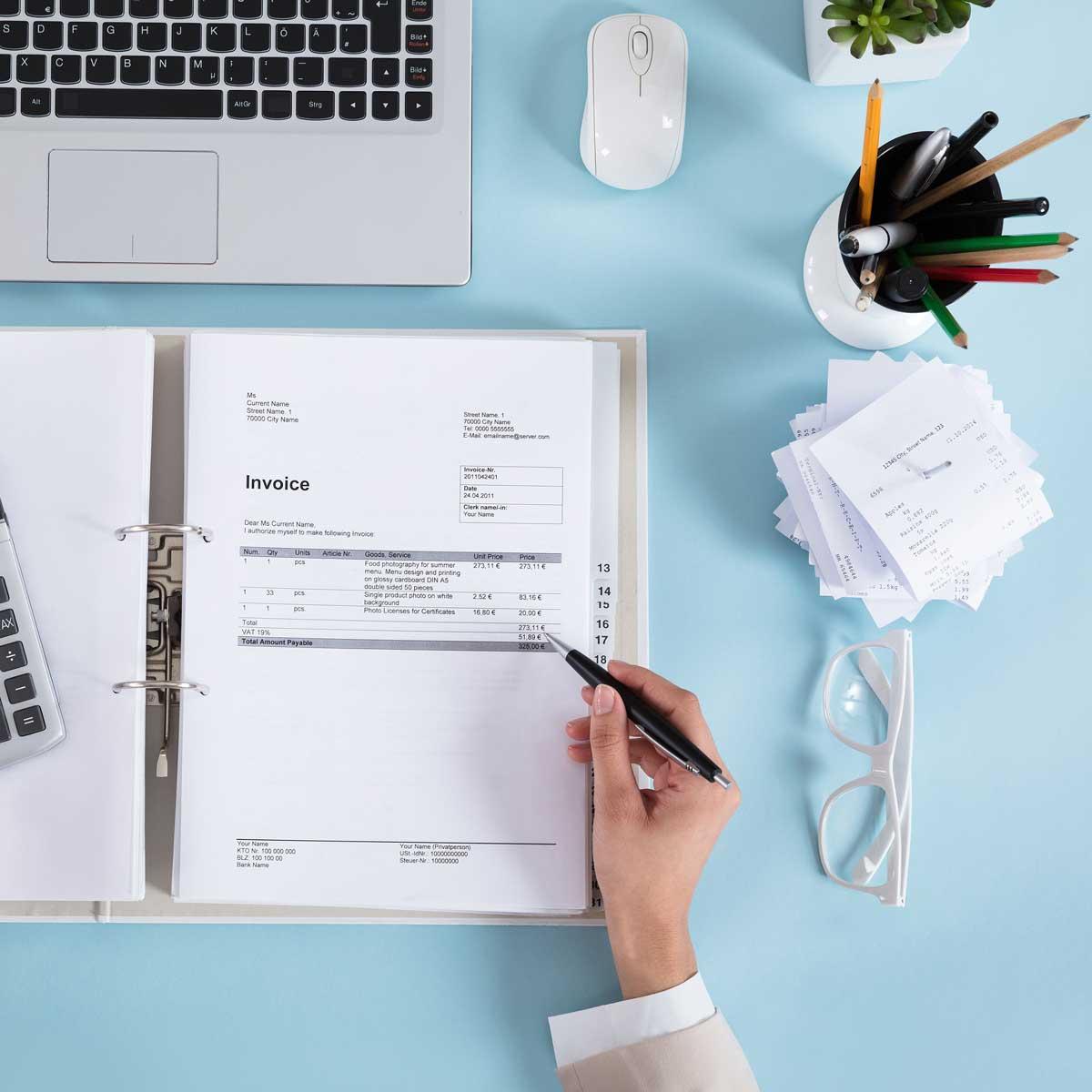 Businesswoman Calculating Invoices