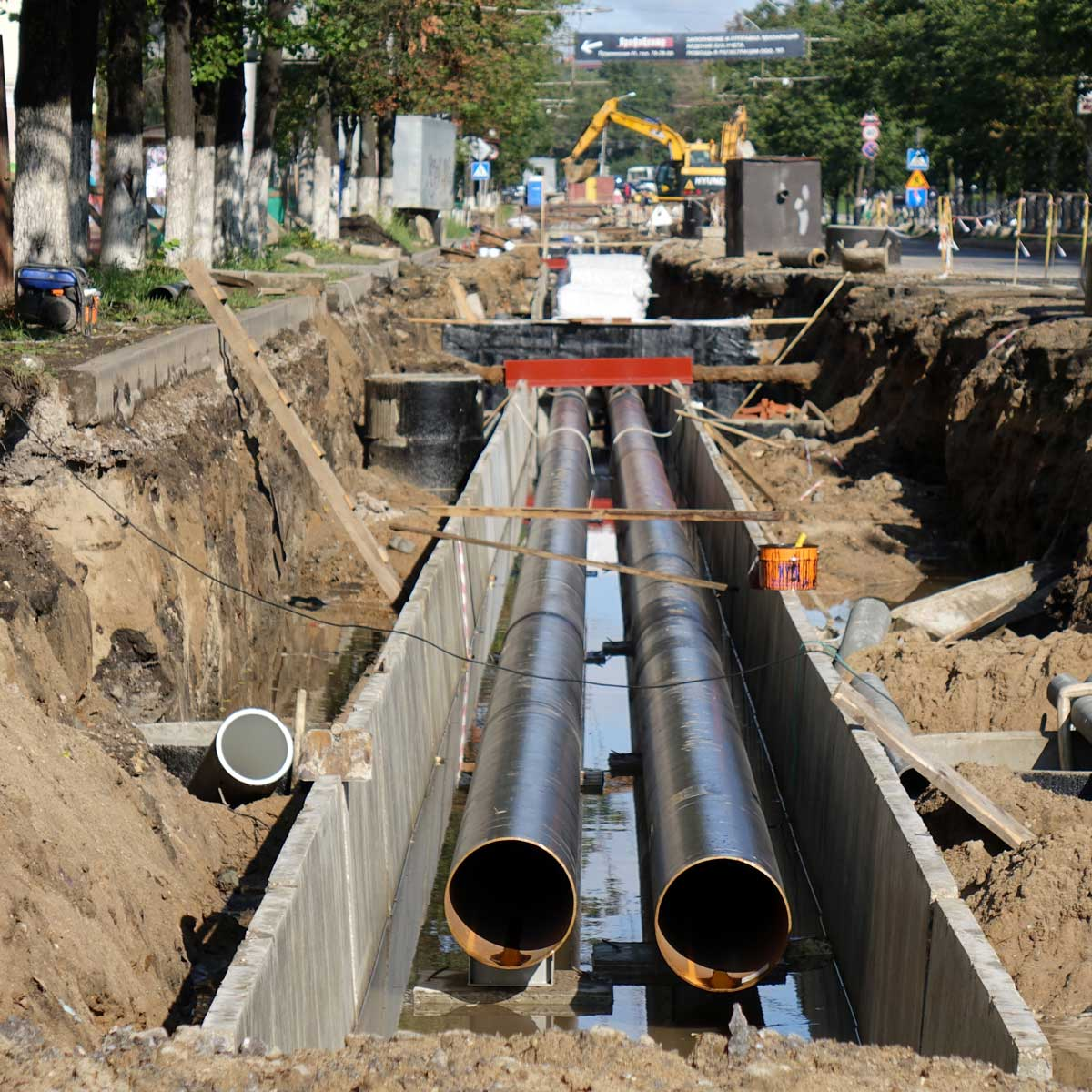 Replacement pipes in the city. Construction of heating mains for municipal infrastructure, the concept of development.