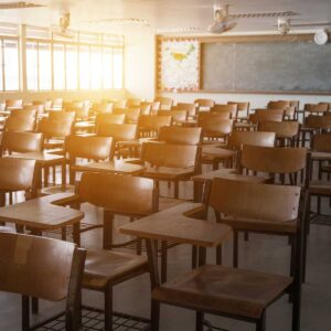 Empty classroom with vintage tone wooden chairs. school concept.