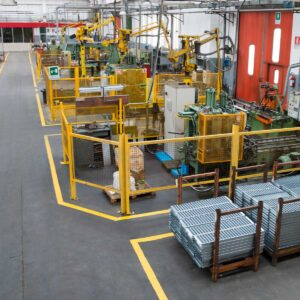 picture of a manufacturing floor with equipment and technology