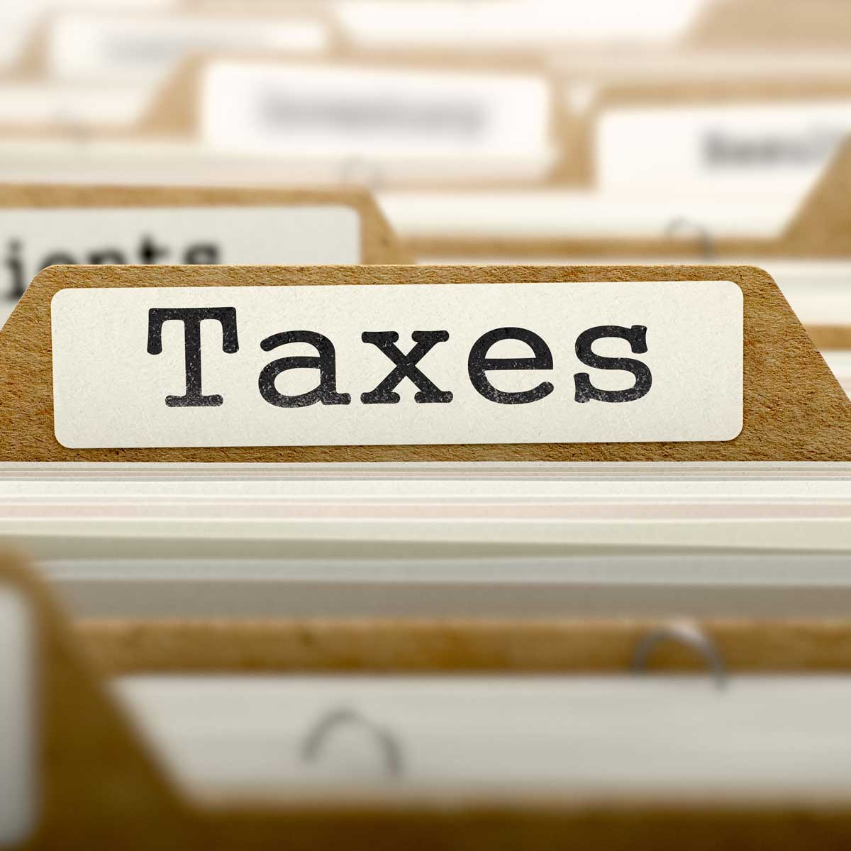 Taxes Concept with Word on Manilla Folder.